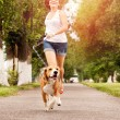 Stock Photo: Active walk with pet