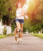 Active walk with pet — Stockfoto