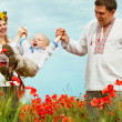 Happy family leisure on poppies field — Stock Photo
