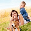 Family leisure with favorite pet   — Stock Photo
