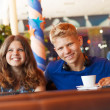 Teenage boy and girl in cafe — Stock Photo