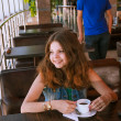 Young girl waiting for a boyfriend in cafe — Foto de Stock