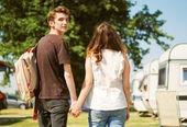 Teenage couple walk touching hand in hand — Stock Photo