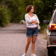 Beautiful girl waiting auto service repair near her SUV Car — Stock Photo