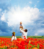 Happy ukrainian family on the field — Stock Photo