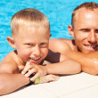 Father and son spent time in pool — Stock Photo