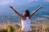 Feeling freedom young woman — Stock Photo