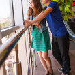 Teenage couple looks on city landscape through the window — Stock Photo