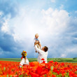 Happy ukrainian family on the field — Stock Photo
