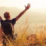 Man greeting golden rising of the sun — Stock Photo #29662917