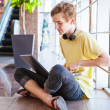 Handsome teenage boy using wifi internet connect — Stock Photo