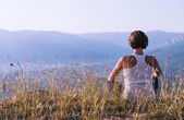 Young woman meditated on the top of mountain — Стоковое фото