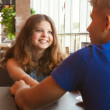 Stock fotografie: Teens couple in cafe close up portrait