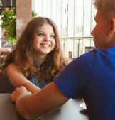 Teens couple in cafe close up portrait — Stock Photo