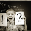 Emotional screaming pupil boy near chalkboard — Stock Photo