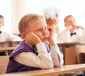 Little pupil boy on his first lesson — Stock Photo