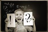 Emotional screaming pupil boy near chalkboard — Stock Photo