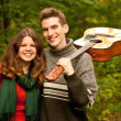 Stock Photo: Happy teenage years: camping,guitar, first love...