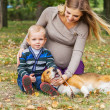 Carefree family scene in autumn park — Stock Photo