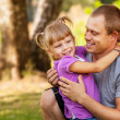 Little daughter playing with her father — Stock Photo #31442331