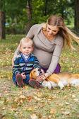 Carefree family scene in autumn park — Stock Photo