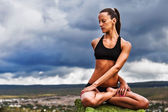 Beautiful slim woman do yoga twist pose — Stock Photo