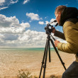 Photographer working outdoor — Stock Photo