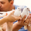Stock Photo: Kissing love couple with pare of white doves