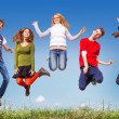 Teens jumping  — Stock Photo