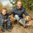 Stock Photo: Father with son and pet resting on the forest glade