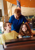 Happy teenagers friends in cafe — Stock Photo