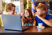 Teens friends spend time together in cafe — Stock Photo