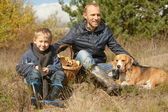 Father with son and pet resting on the forest glade — Stock Photo