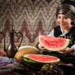 Eastern boy with watermelon portrait — Stock Photo