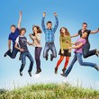Happy teen jumpers — Stock Photo