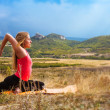 Young woman has outdoor yoga practice — Stok fotoğraf