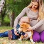 Little boy hugs his pet on walk — Stock Photo