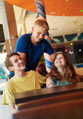 Three teens friends in cafe — Stock Photo