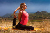 Young woman make yoga pose deeply concentrated — Stok fotoğraf