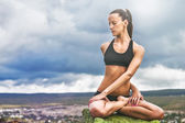 Beautiful slim woman do yoga twist pose — Foto de Stock
