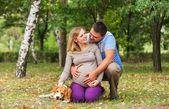 Happy couple of future parents on the walk — Stock Photo