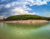 High mountain Lake with blue sky Cloudscape wide angle — Stock Photo