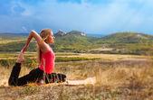 Young woman has outdoor yoga practice — Стоковое фото
