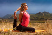 Young woman make yoga pose deeply concentrated — Stock Photo