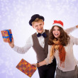 Teenage boy and girl with christmas presents — Stock Photo