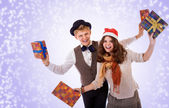 Teenage boy and girl with christmas presents — Foto de Stock