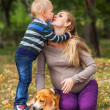 Stock Photo: Little son kissing his pregnant mother
