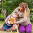 Family on walk with favorite pet — Stock Photo