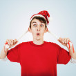 Young man in funny santa hat with pigtails — Stock Photo