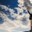 Man with victory gesture on the top of mountain — Stock Photo